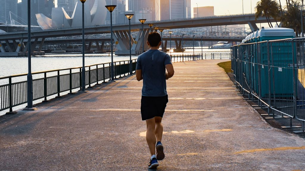 man jogging singapore reasons why cold pressed juices are worth the price tag unsplash Gervyn Louis