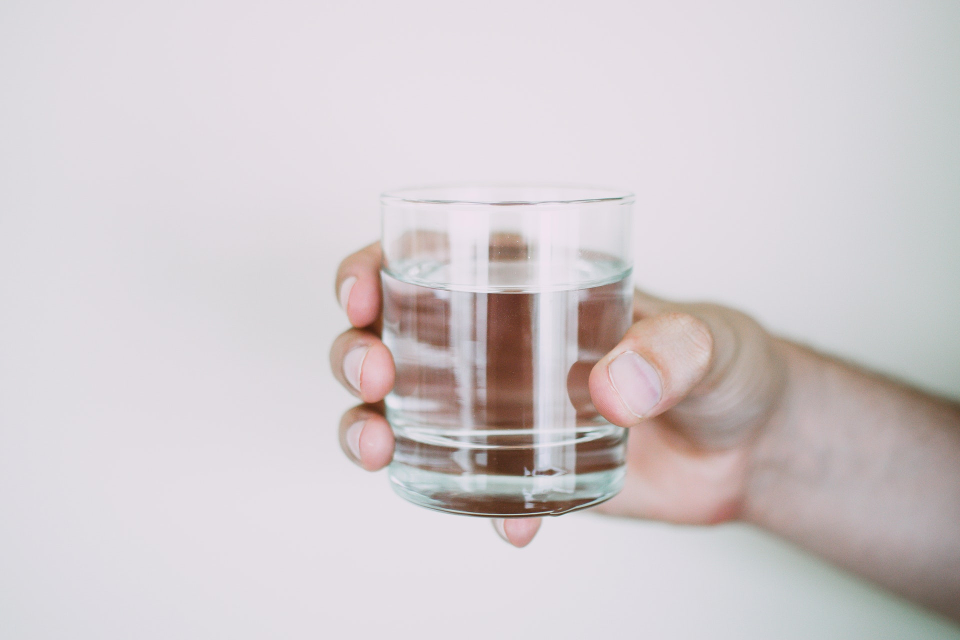 person holding glass of water Lisa Fotios