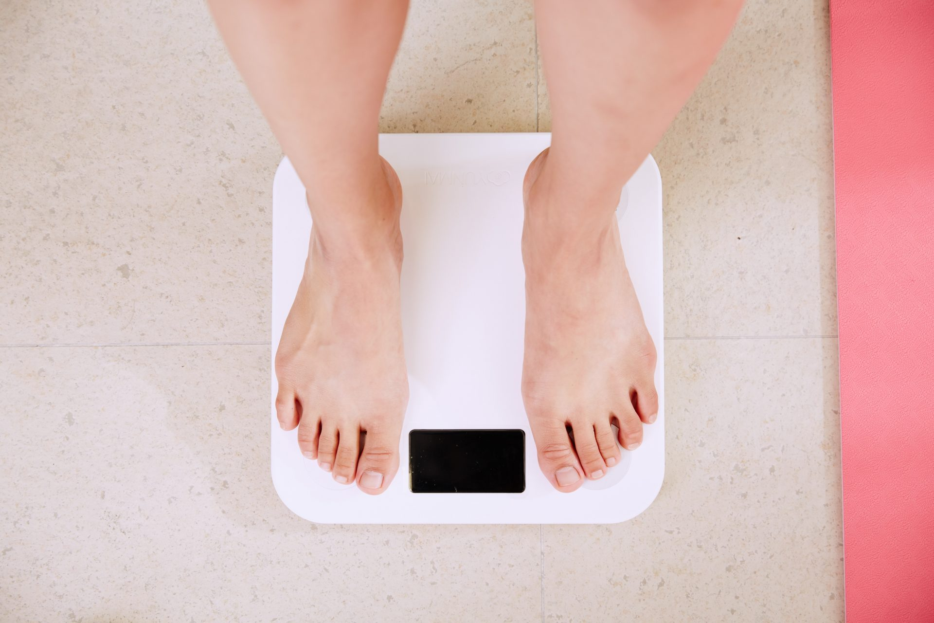 standing on weighing scale unsplash